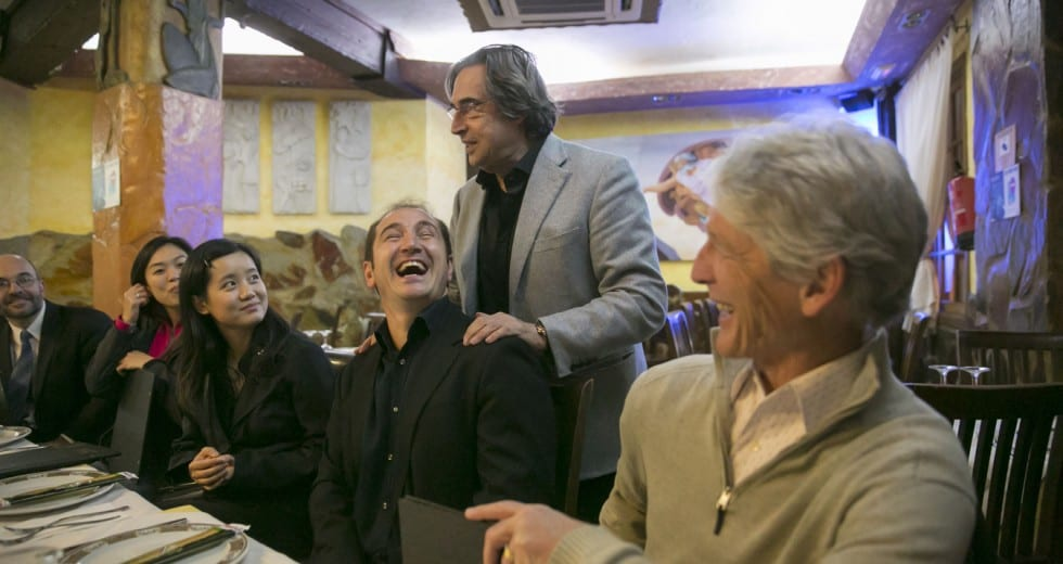 Maestro Muti greets CSO musicians and their colleagues from the Orquesta Sinfonica de Tenerife at dinner on Sunday after their recital.