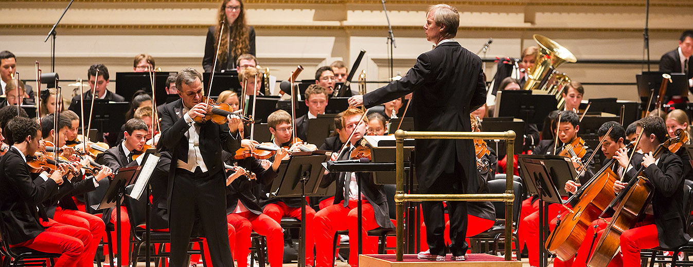 Gil Shaham (left) with the National Youth Orchestra of the USA, conducted by David Robertson, at Carnegie Hall in July 2014. | Photo by Chris Lee