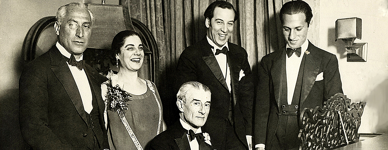 Birthday party honoring Maurice Ravel in New York City, March 8, 1928. From left: Oskar Fried; Éva Gauthier; Ravel at piano; Manoah Leide-Tedesco; and George Gershwin.