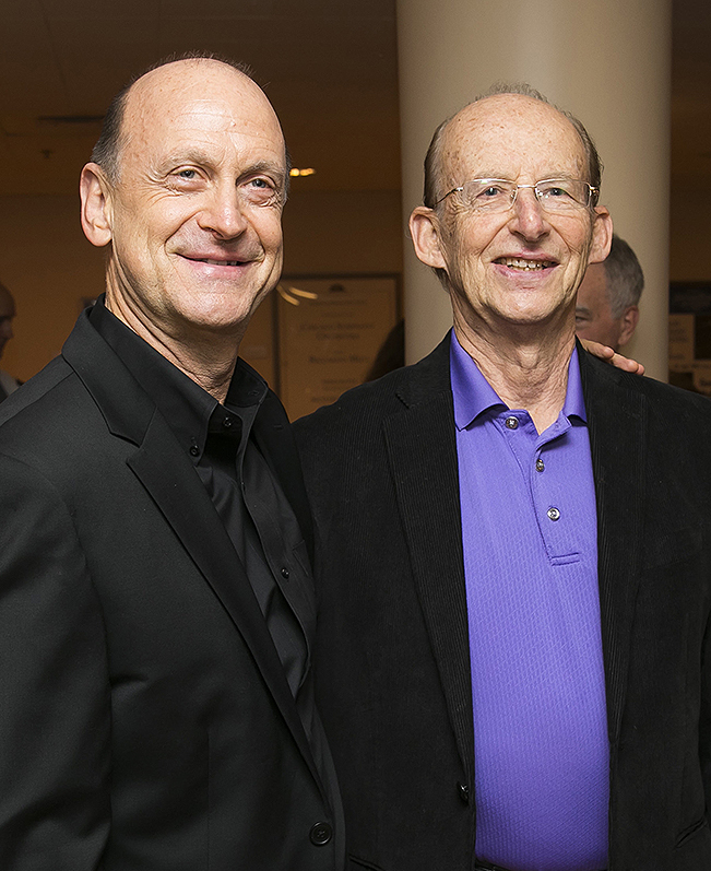 Michael Mulcahy (left) and Jay Friedman take in a post-concert reception after the world-premiere performance Oct. 6 of Carl Vine's Hallucinations: A Concerto for Trombone and Orchestra, written for Mulcahy. | © Todd Rosenberg Photography 2016