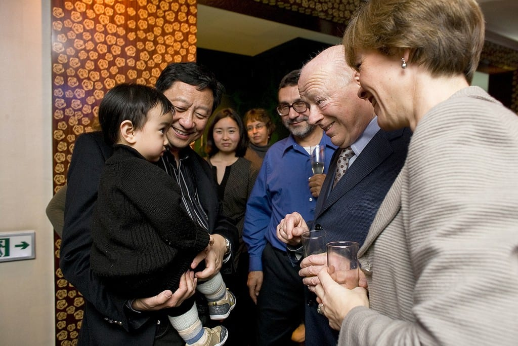 Shanghai-born Daniel Chang, with father Li-Kuo Chang, meets maestro Bernard Haitink on the CSO's 2009 tour. | © Todd Rosenberg Photography 2009